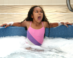 young girl ready to jump out of hot tub