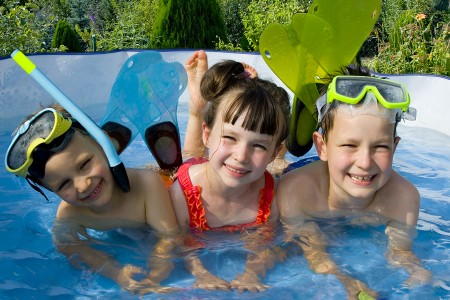 three young swimmers in pool